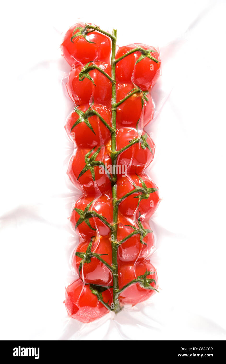 bunch of tomatoes vacuum-packed - Stock Image