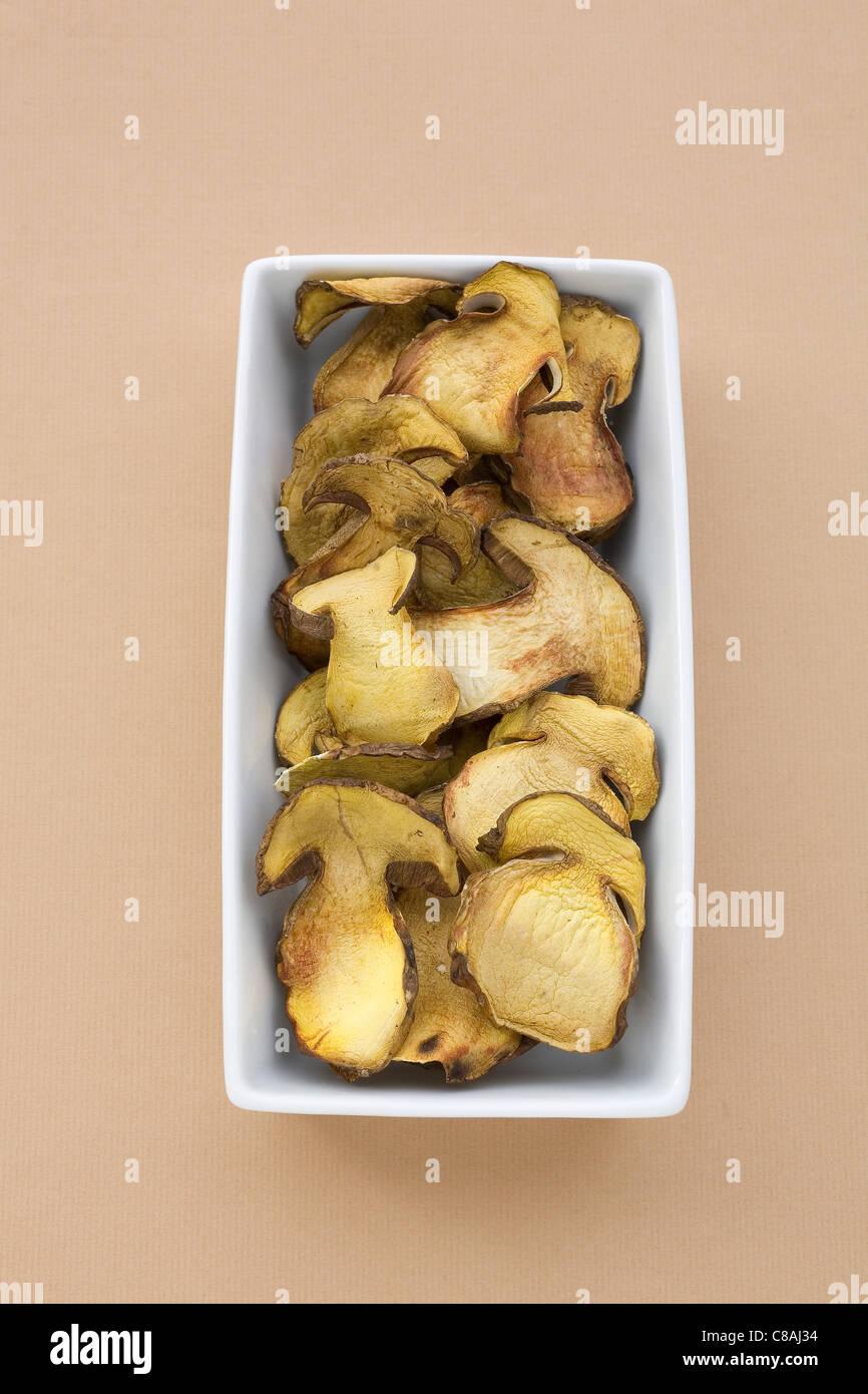 Dish of sliced boletus mushrooms - Stock Image