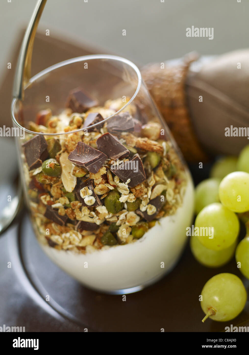 Yoghurt with cereals,dried fruit and chocolate chips - Stock Image