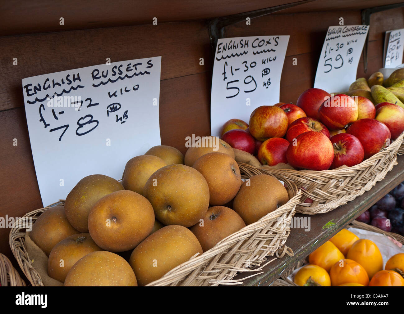 Village greengrocer display of local English apples including  baskets of Russets and Cox's - Stock Image
