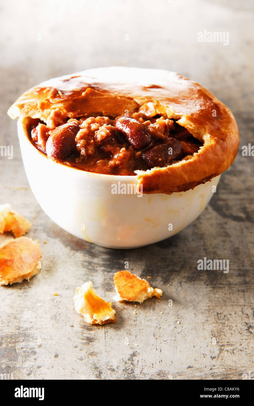 Chili con carne with pastry crust - Stock Image