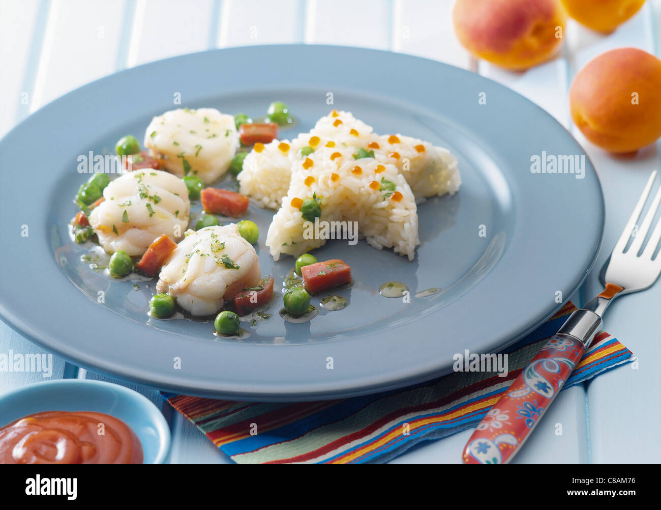 Monkfish with herb sauce,star-shaped rice timbale - Stock Image