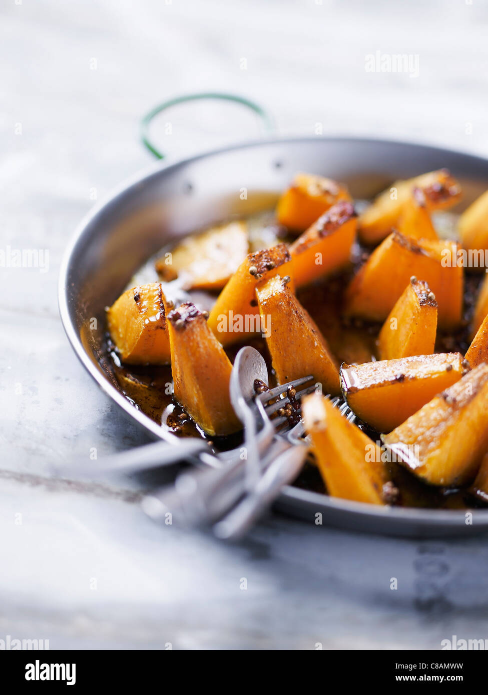 Giraumont pumpkin baked with honey and spices Stock Photo