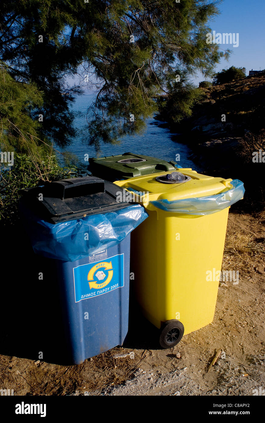 Trash cans by the beach - Stock Image