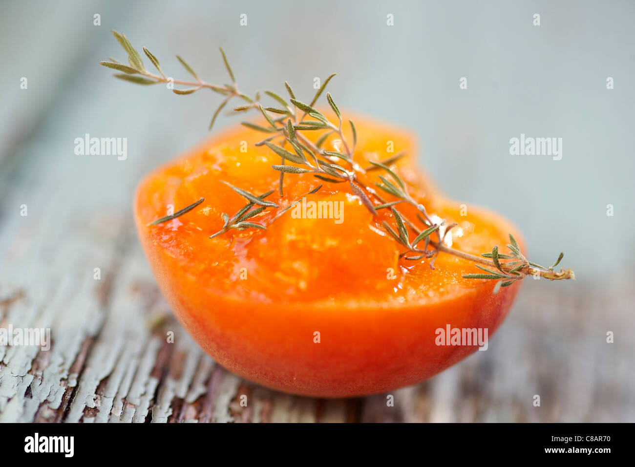 Half an apricot and rosemary - Stock Image