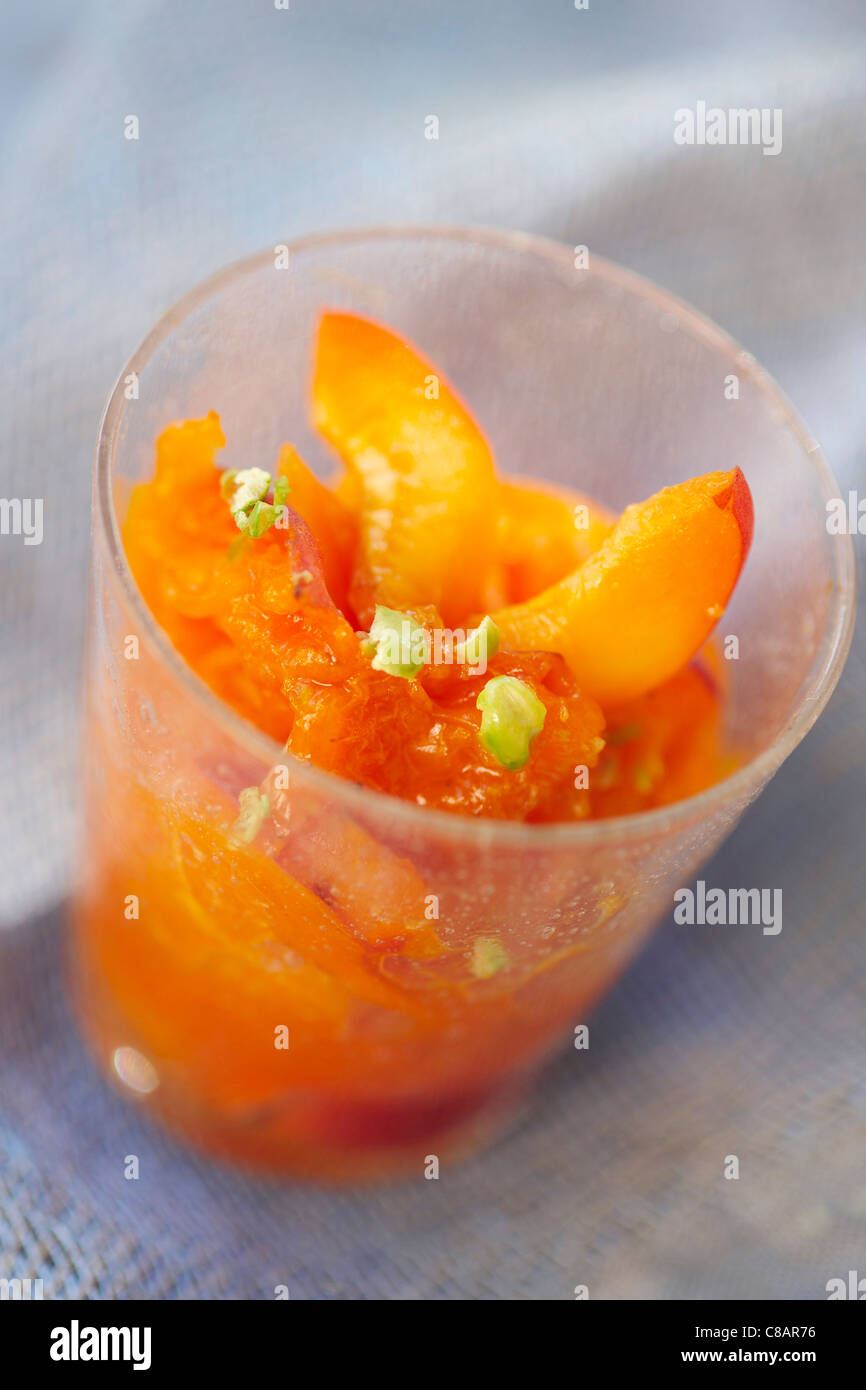 Apricot fruit salad with pistachios - Stock Image