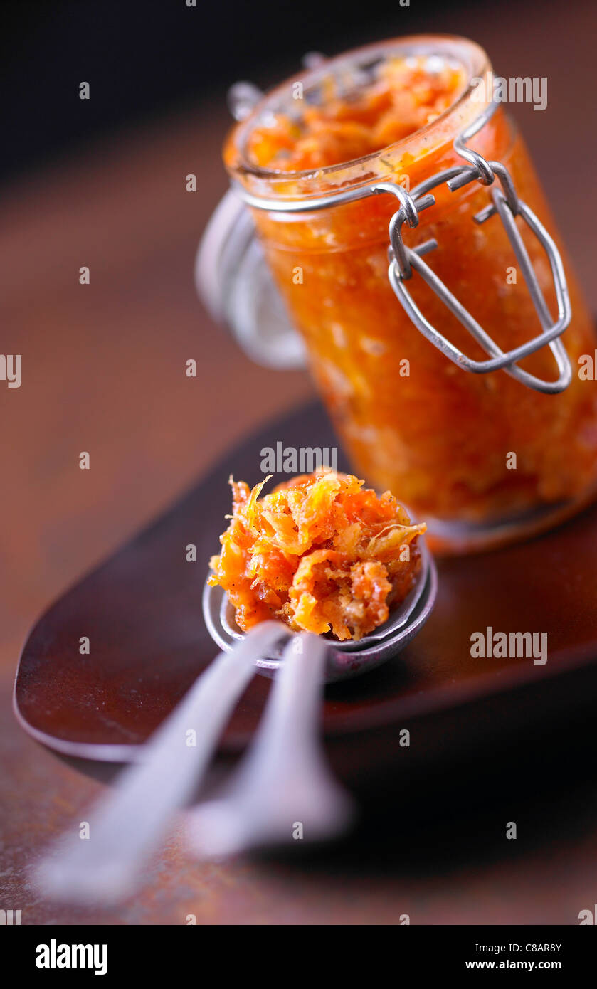 Jar and spoonful of pumpkin and chestnut chutney - Stock Image