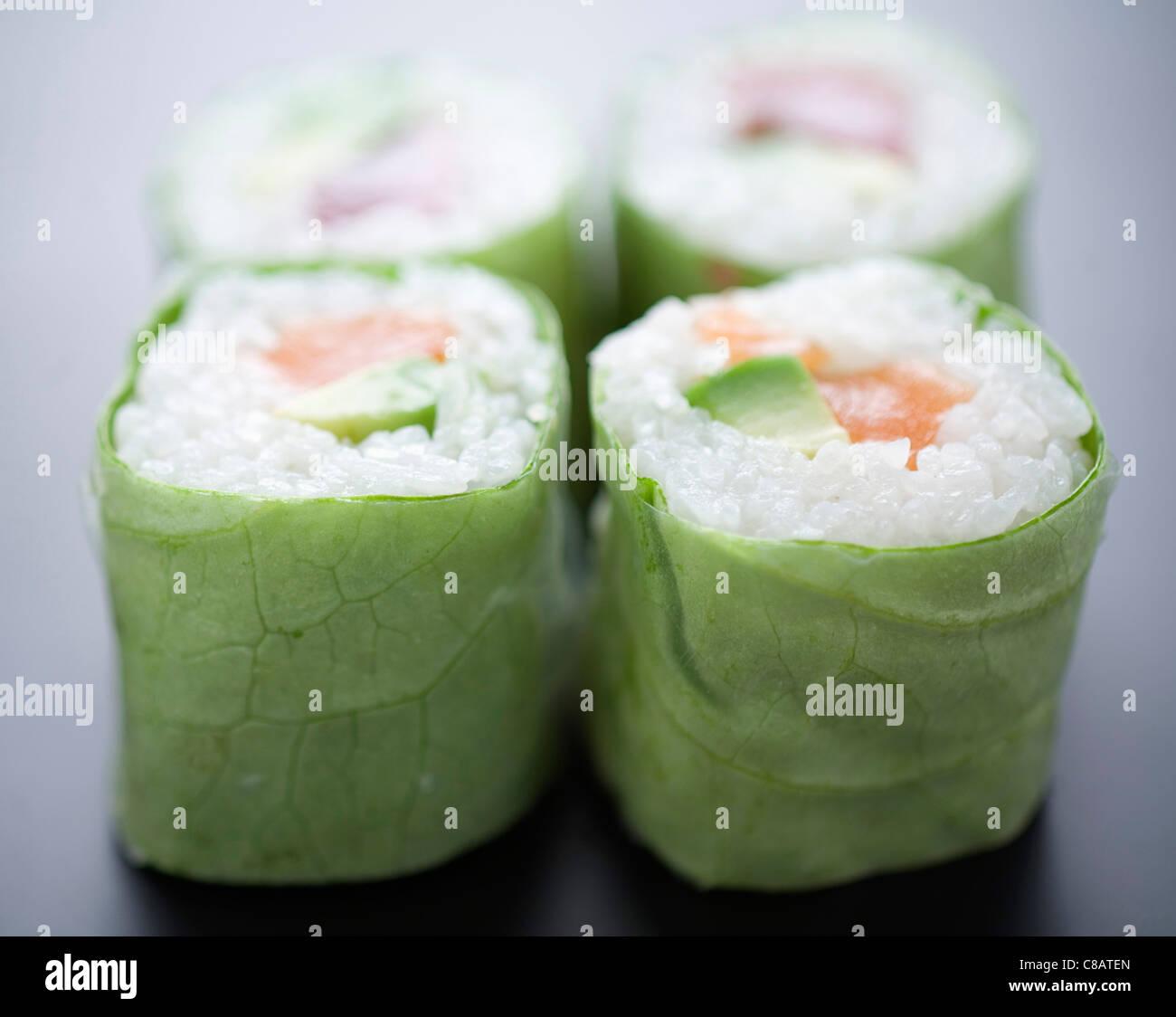 Salmon and avocado lettuce makis Stock Photo