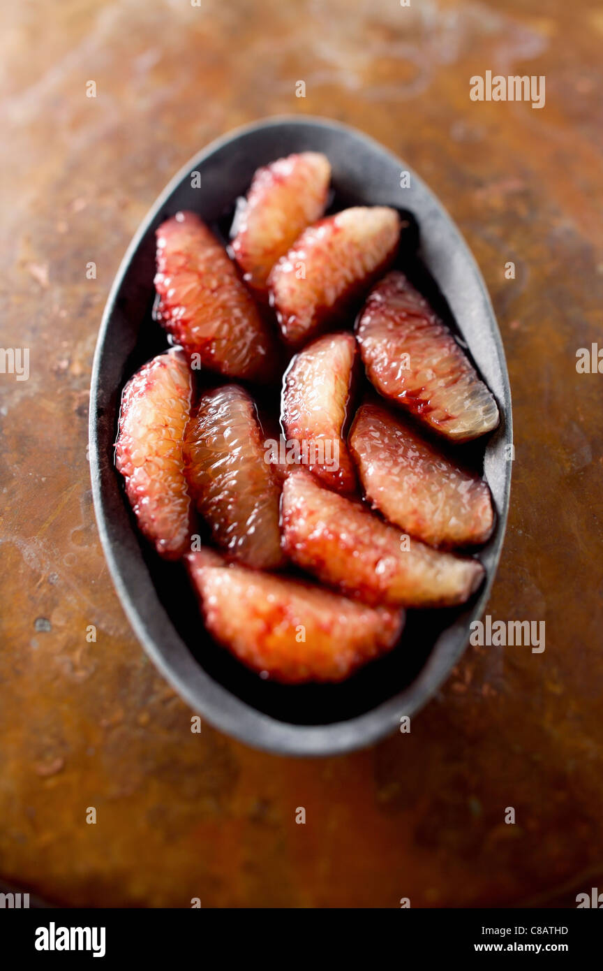 Grapefruit with red wine syrup - Stock Image