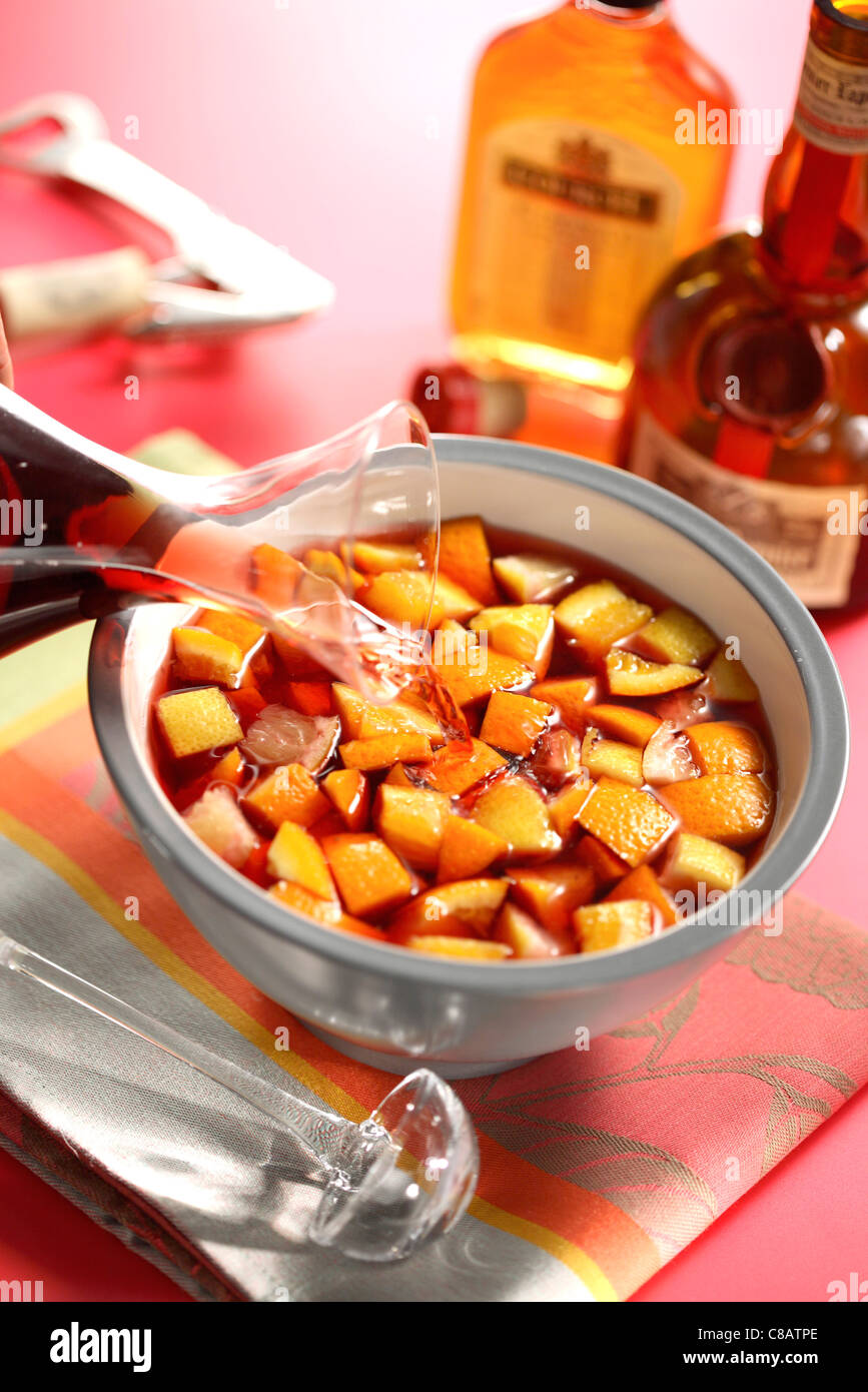 Pouring the red wine onto the fruit - Stock Image