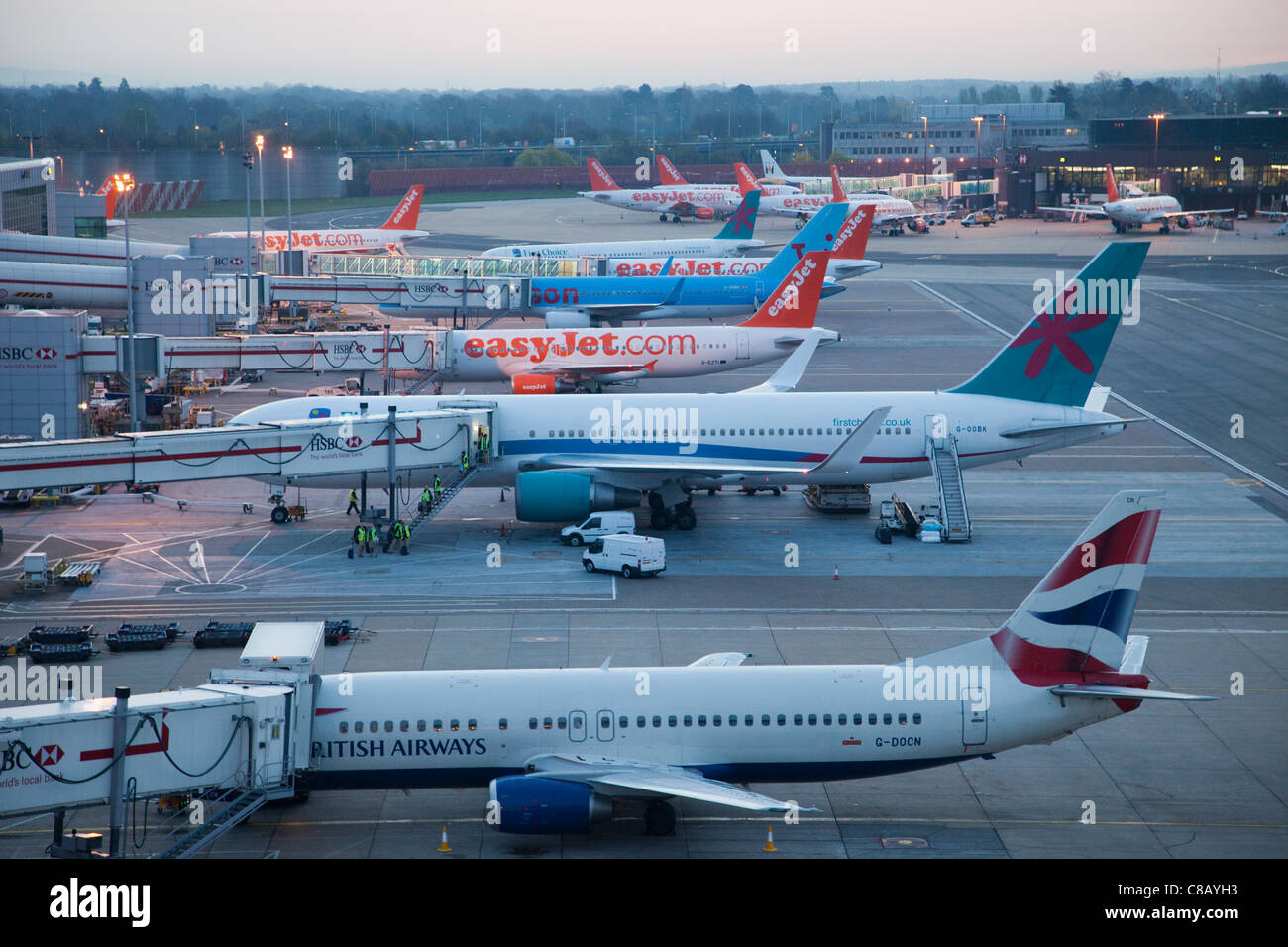 England, London, Gatwick Airport, Parked Aeroplanes - Stock Image