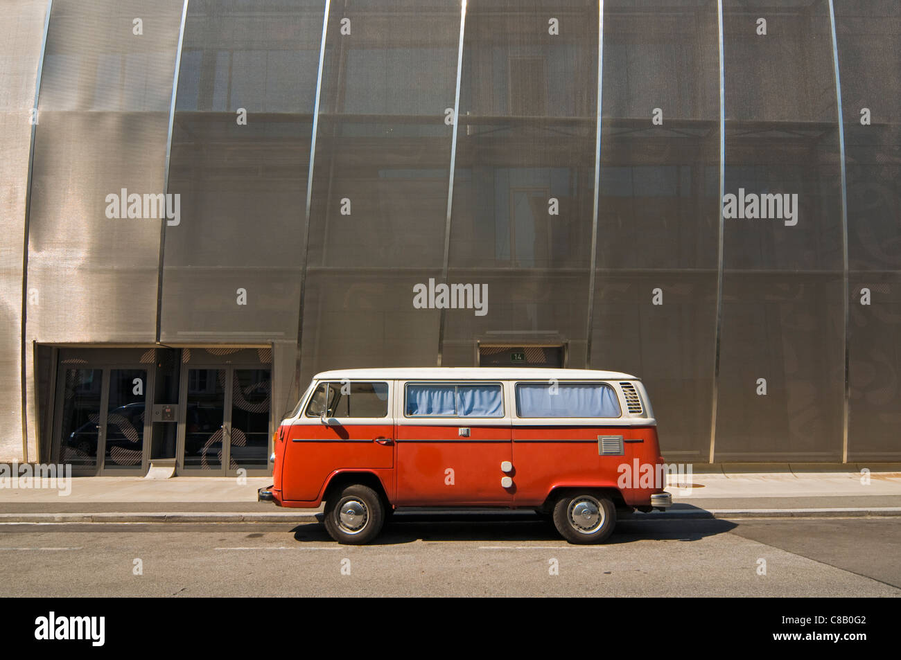Classic Red VW (Volkswagen) T2 Van outside MUMUTH (House of Music and Music Drama) Buidling, Kunst University Graz, - Stock Image
