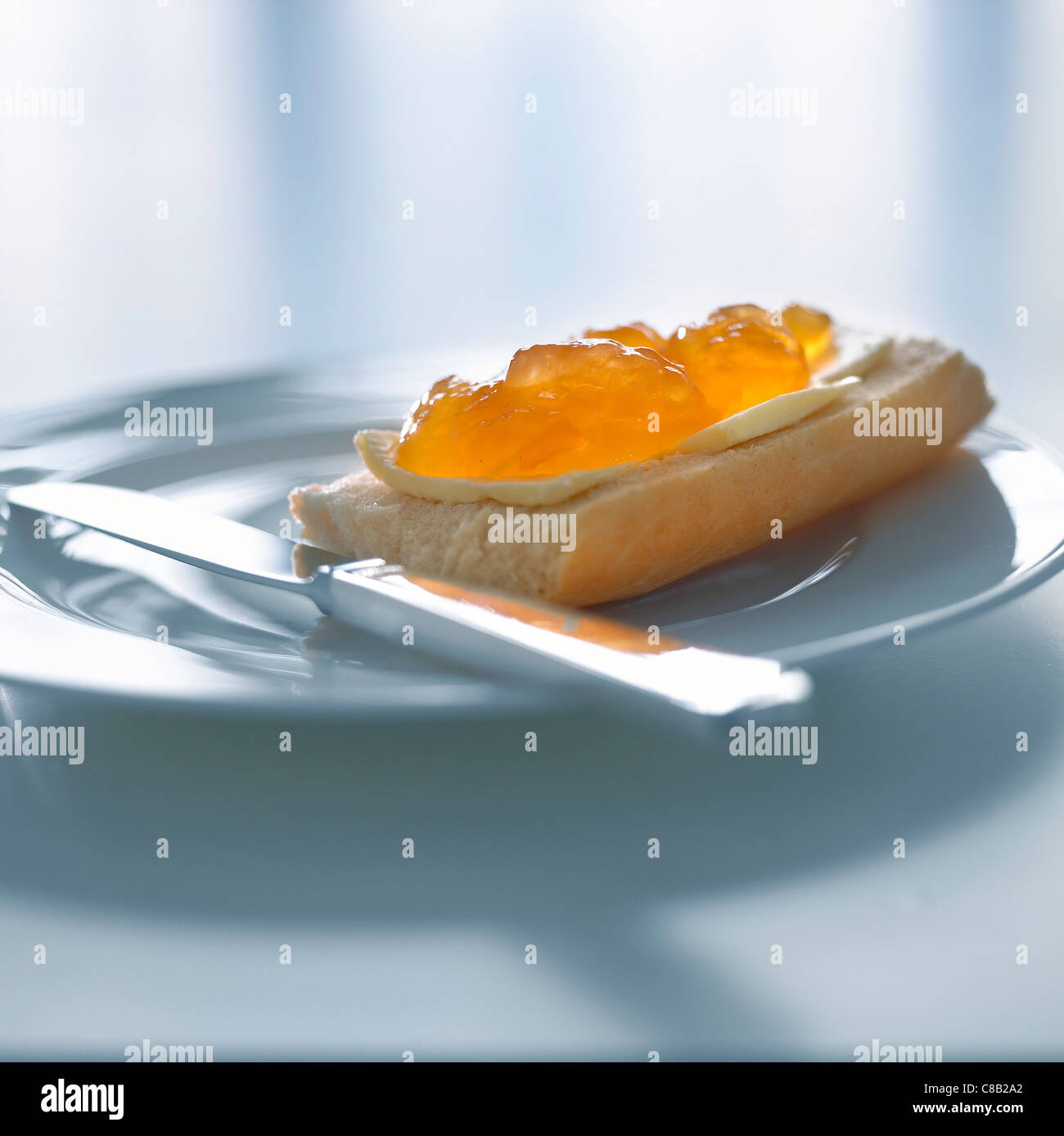 Marmalade on bread and butter - Stock Image