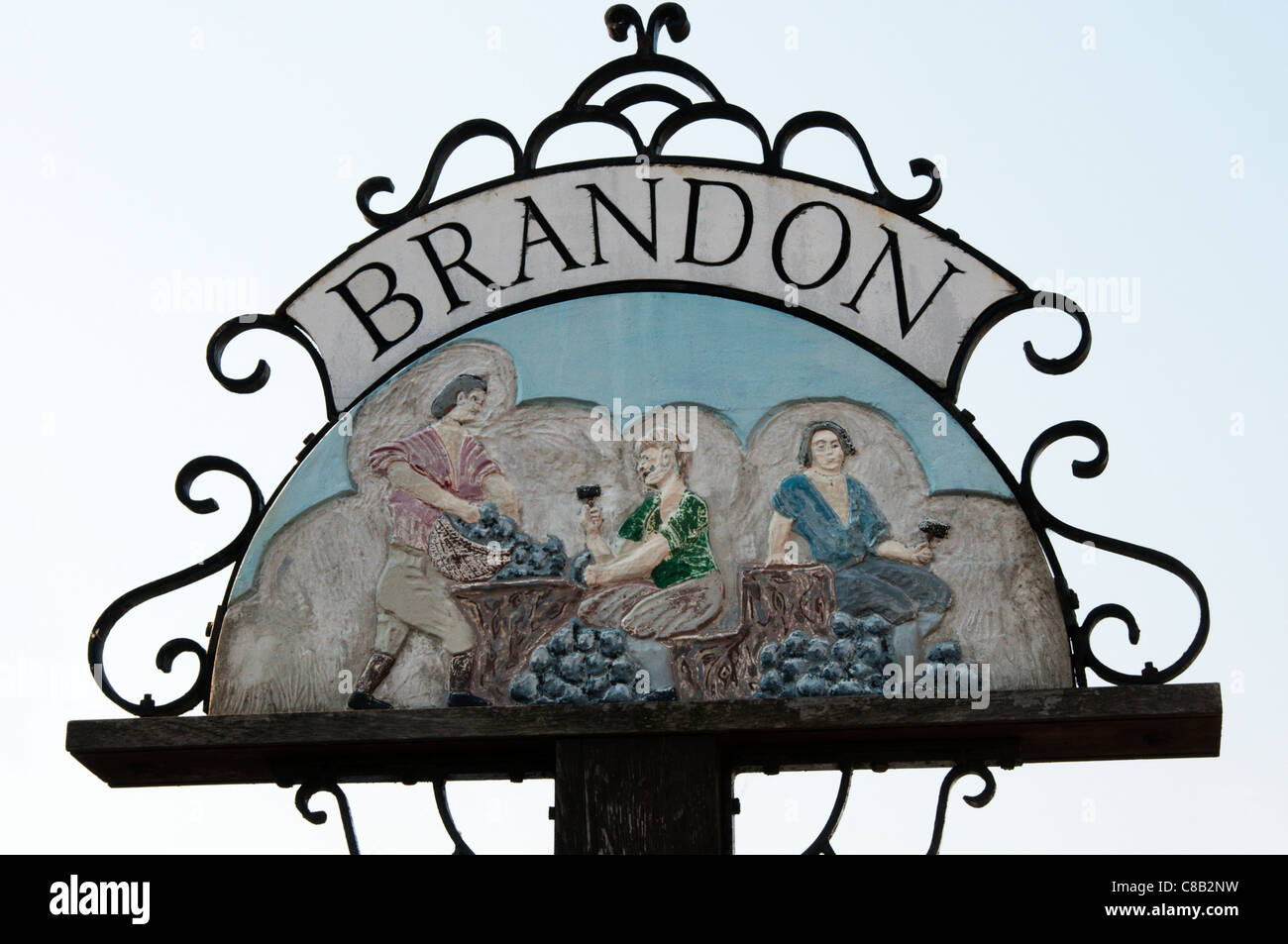 The town sign for Brandon shows flint knappers at work - at one time a local industry. - Stock Image