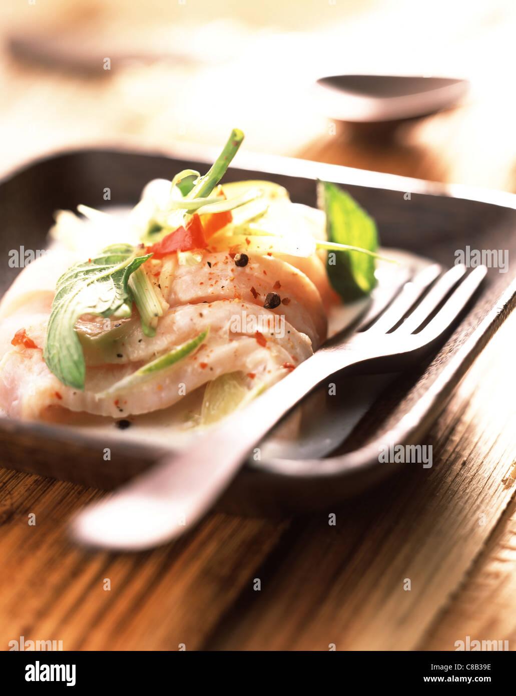 Grouper fish marinated in coconut milk - Stock Image