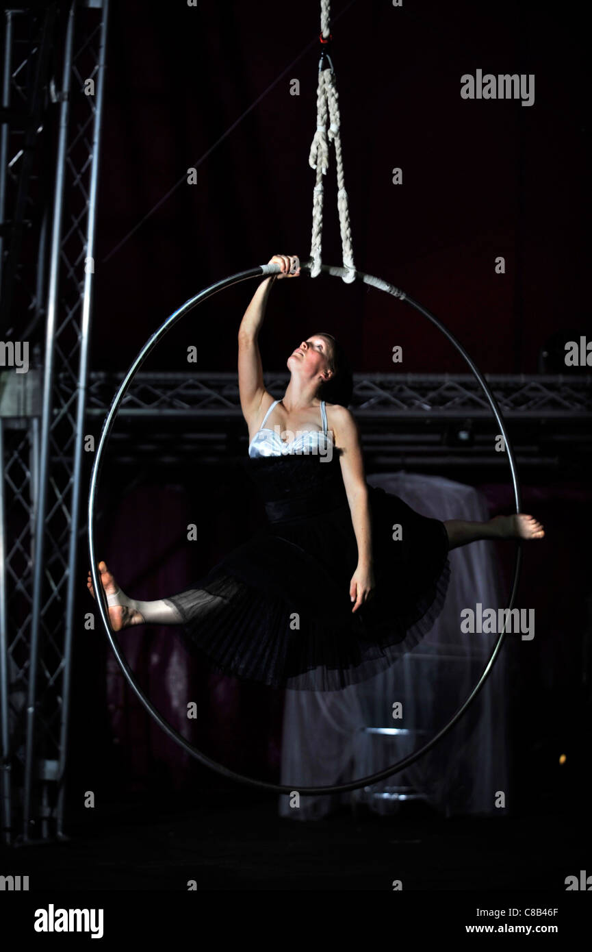 Aerial Hoop performer Shaena Brandell practising with the Nofitstate Circus on tour in South Wales UK - Stock Image
