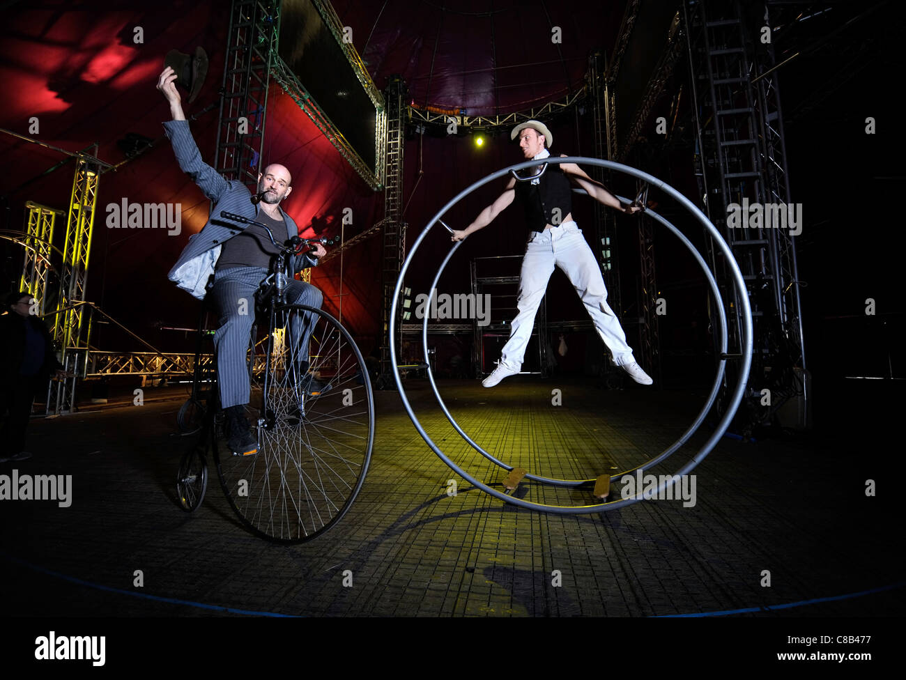 Performers Marco Fiera left with Simone Riccio on a german wheel practising with the Nofitstate Circus on tour in - Stock Image