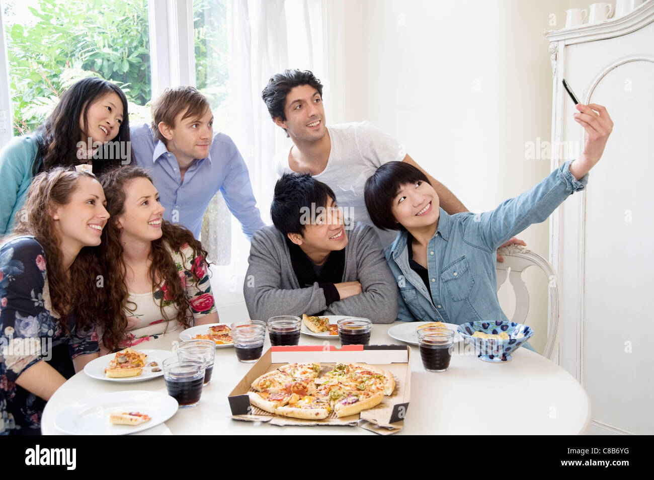 Group of friends taking self portrait photograph Stock Photo