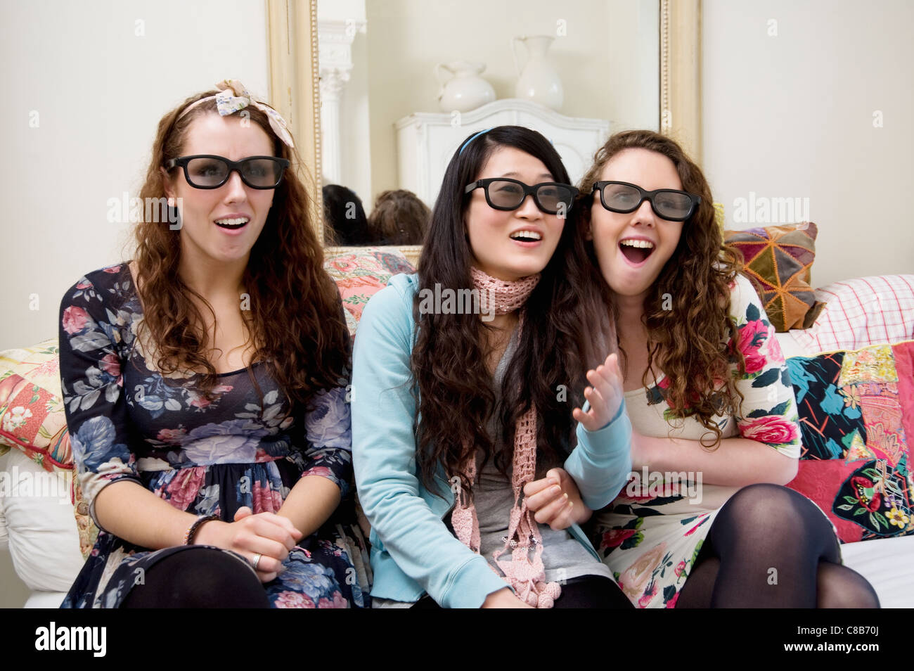 Surprised friends looking at something interesting - Stock Image