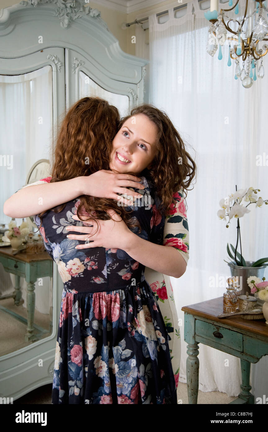 Happy siblings hugging each other Stock Photo