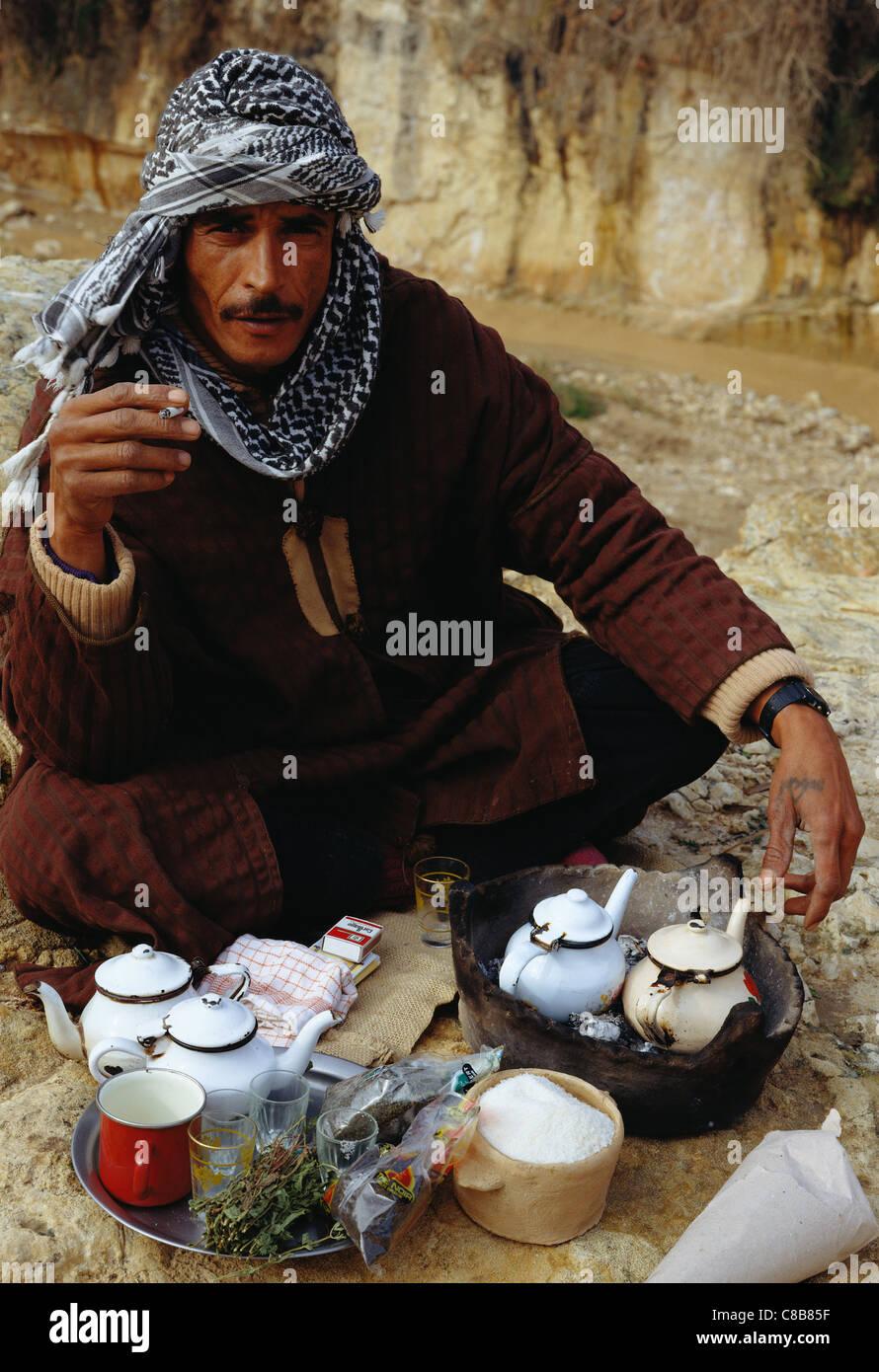 man cross-legged in front of tea - Stock Image