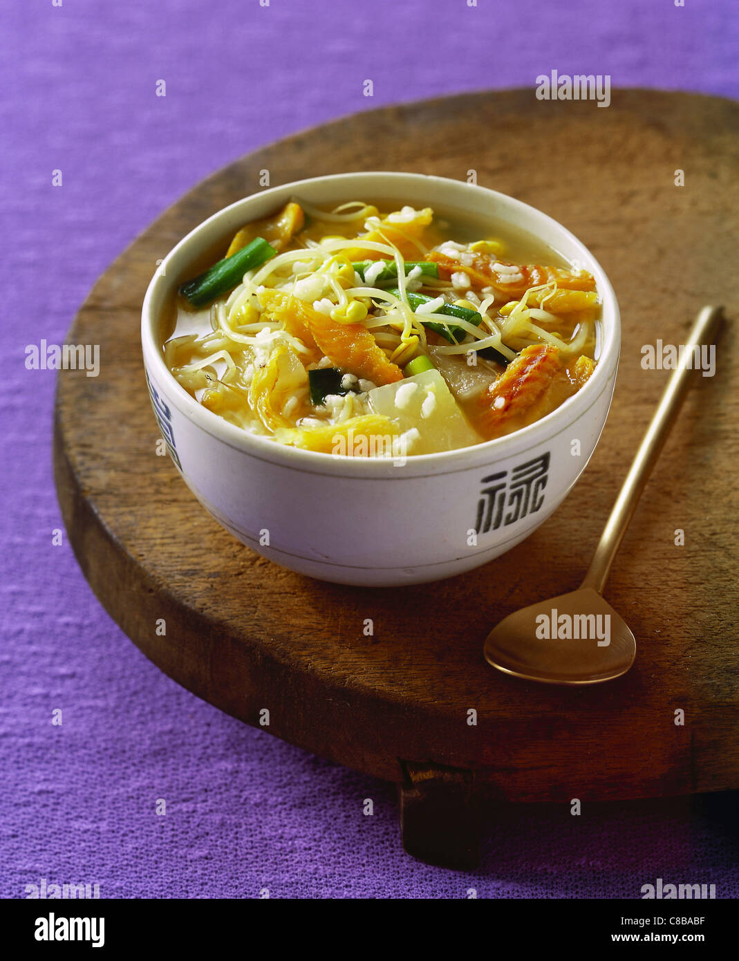 rice soup with dried fish, cabbage and soybeans - Stock Image