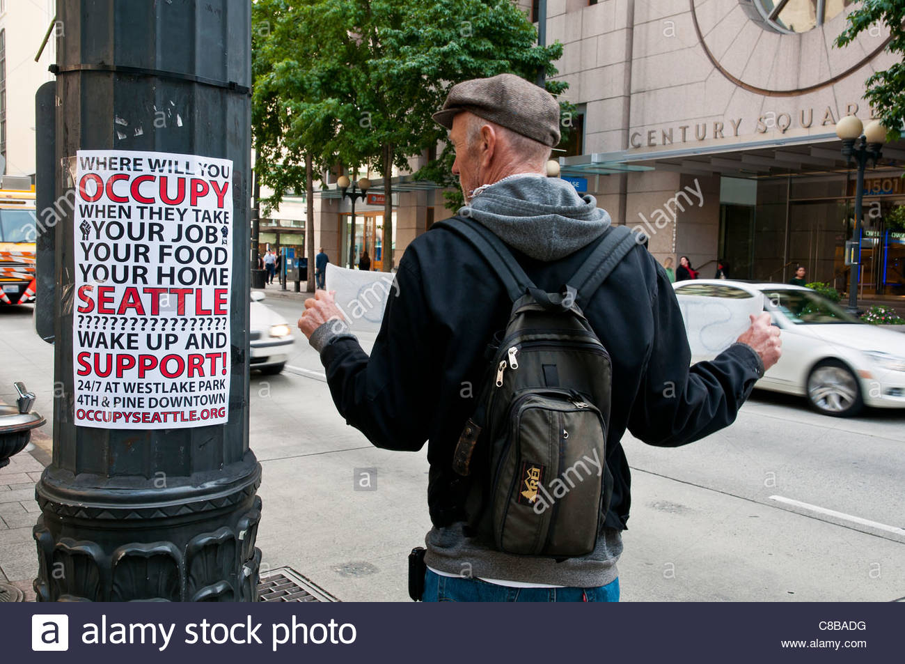 Caucasian adult male holding protest sign during Occupy Seattle march, Westlake Park, Seattle, Washington, USA - Stock Image