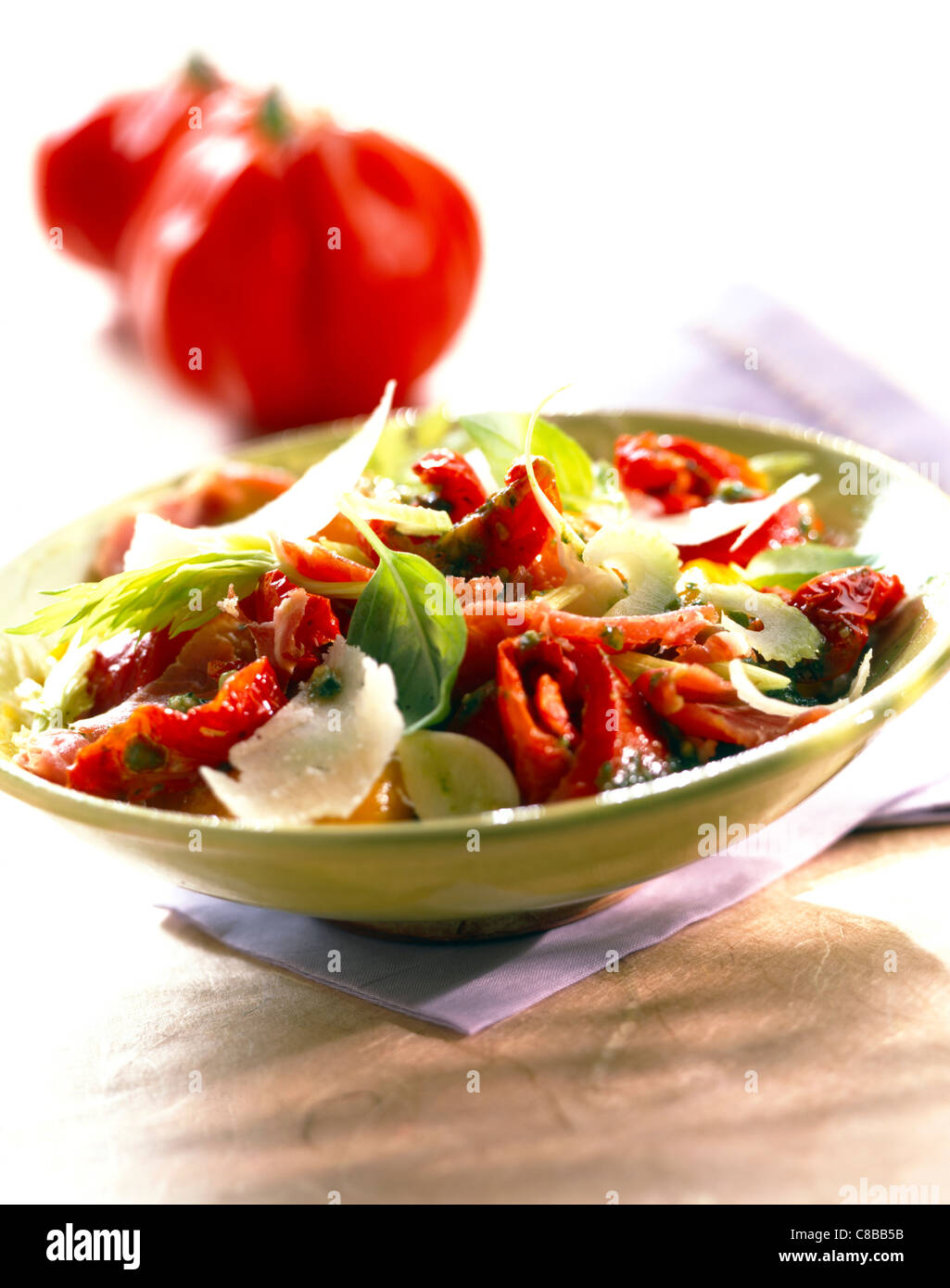 marinated peppers, preserved tomato and parmesan salad - Stock Image