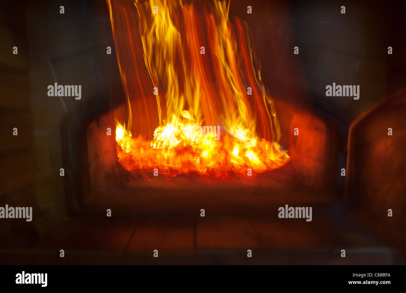 Wood coals glowing inside fireplace - Stock Image