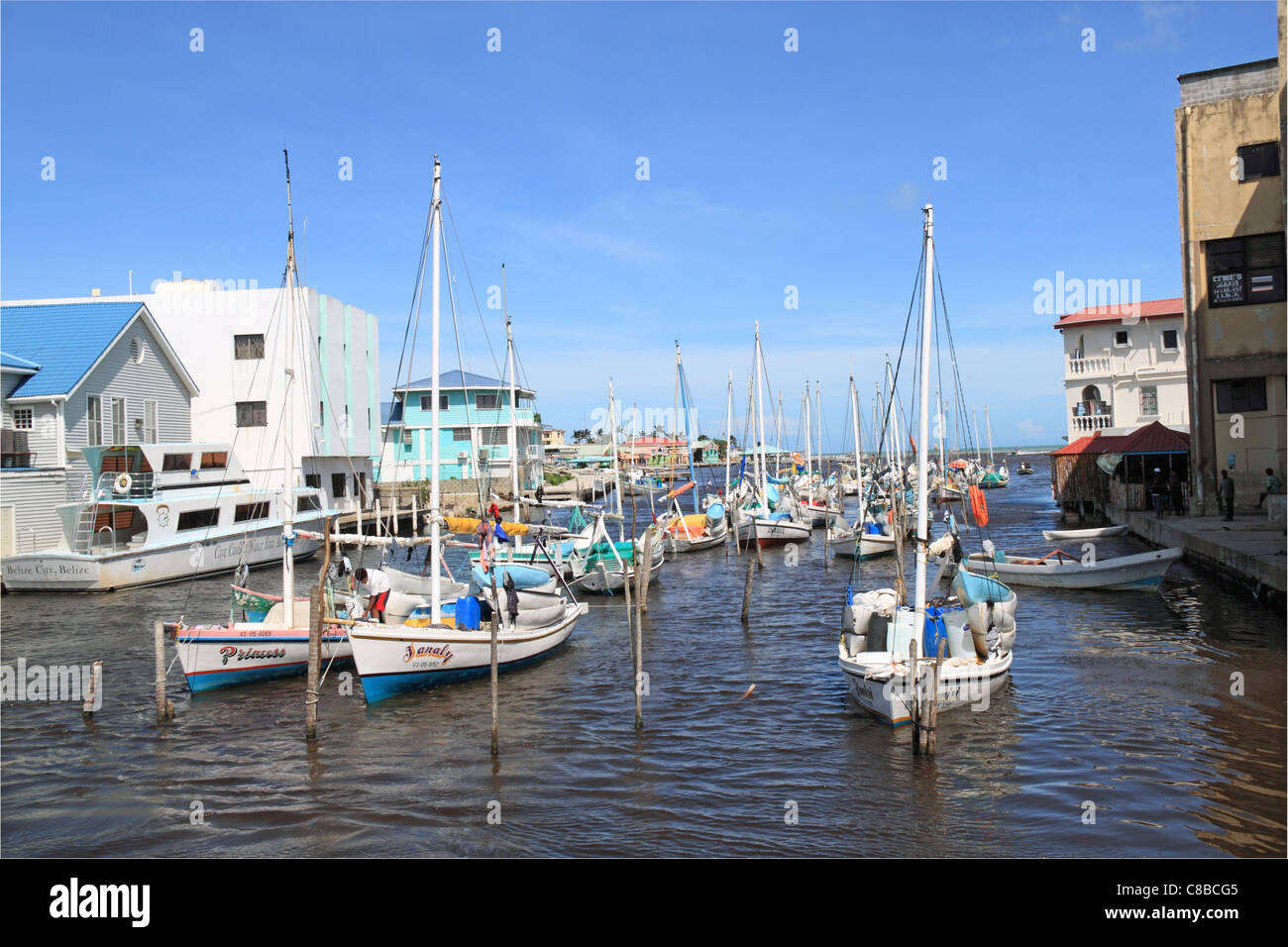 Boats on Haulover Creek, Marine Terminal on left, Fort George, Belize City, Belize, Caribbean, Central America - Stock Image
