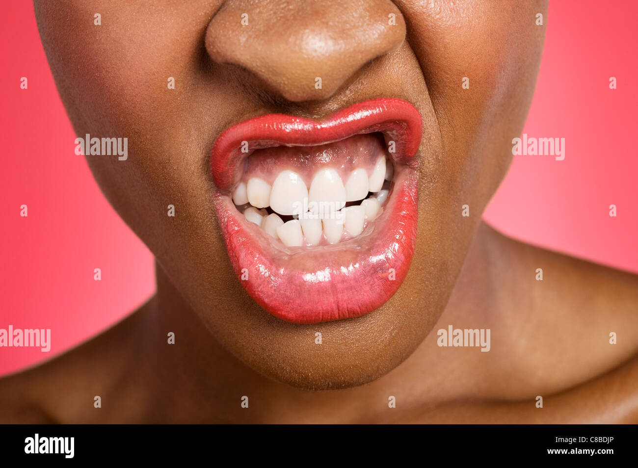 Young woman making face - Stock Image