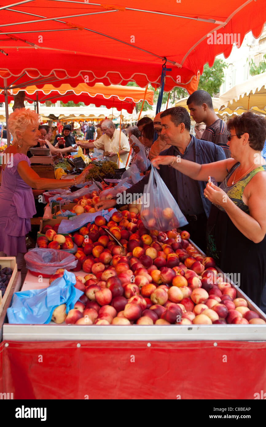customers buying fruit at the market place Toulon France - Stock Image