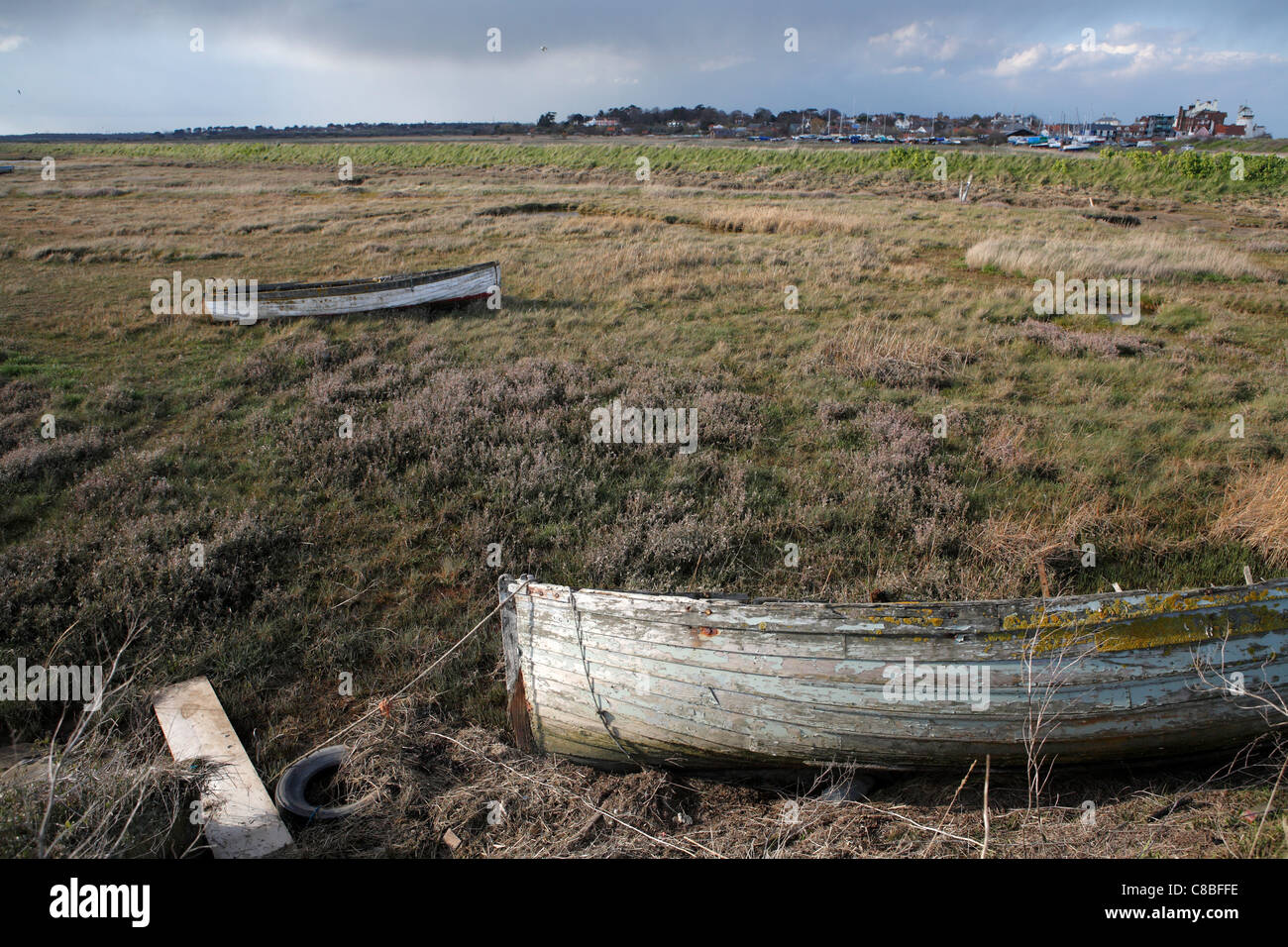 Abandoned clinker built boats in the saltings Slaughden Quay, Suffolk, UK Stock Photo
