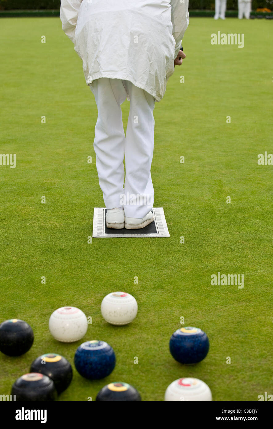 A person playing Lawn Bowls. - Stock Image