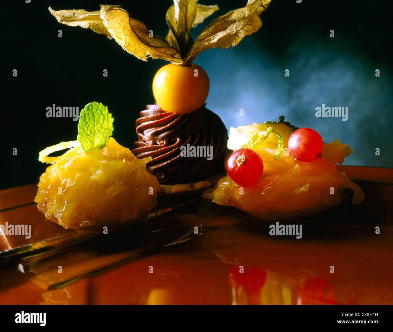 Three tartlet chocolate and fruit dessert by Pierre Hermé - Stock Image