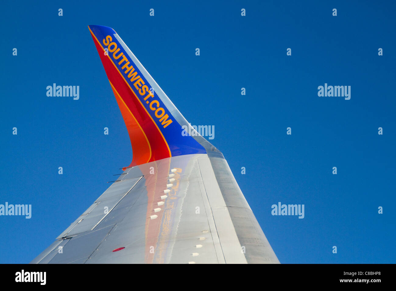 The wing of a Southwest Boeing 737 in flight. - Stock Image