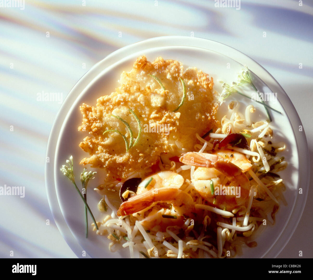 Far Eastern salad and rice cakes - Stock Image
