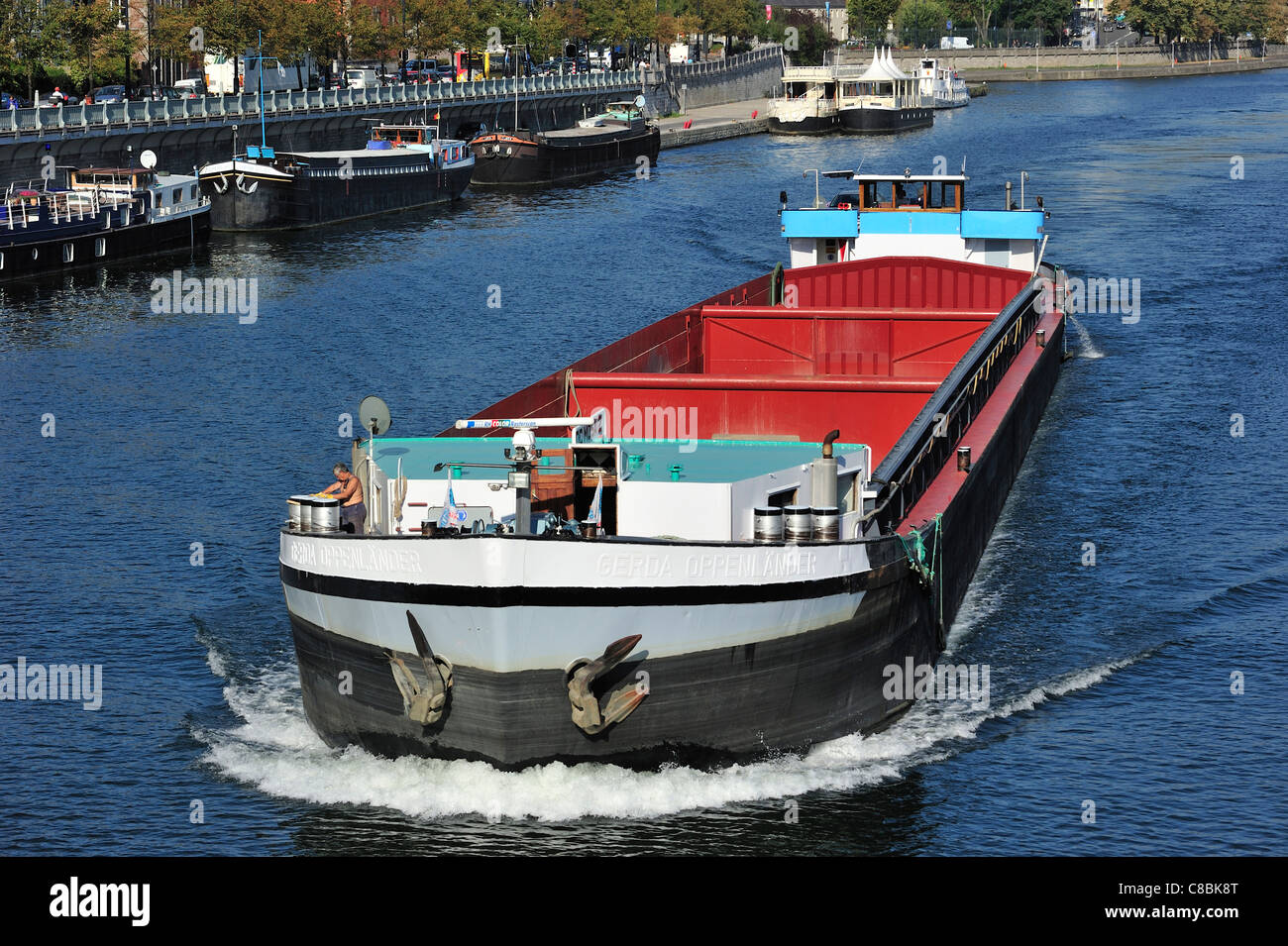 Empty inland vessel / canal barge on the river Meuse at Namur, Belgium - Stock Image