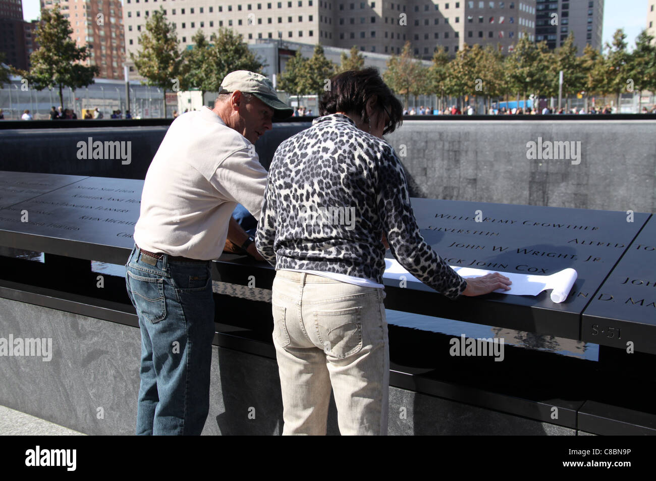 Visitors Making a Rubbing of a Name at the-  Newly Opened to the Public-  National September 11th Memorial in New - Stock Image