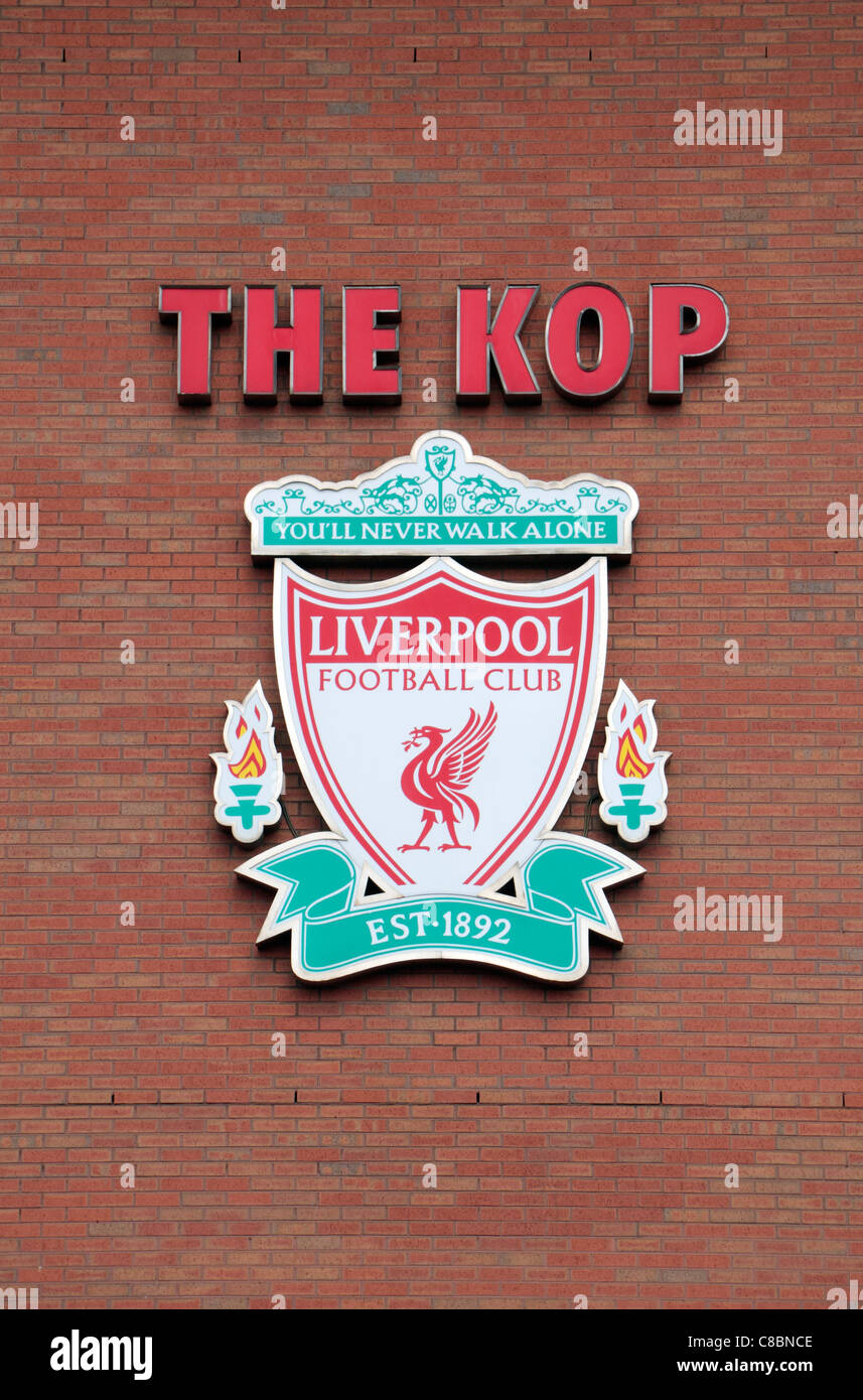 Liverpool official badge on the external wall of the Kop end at Anfield, the home ground of Liverpool Football club. - Stock Image