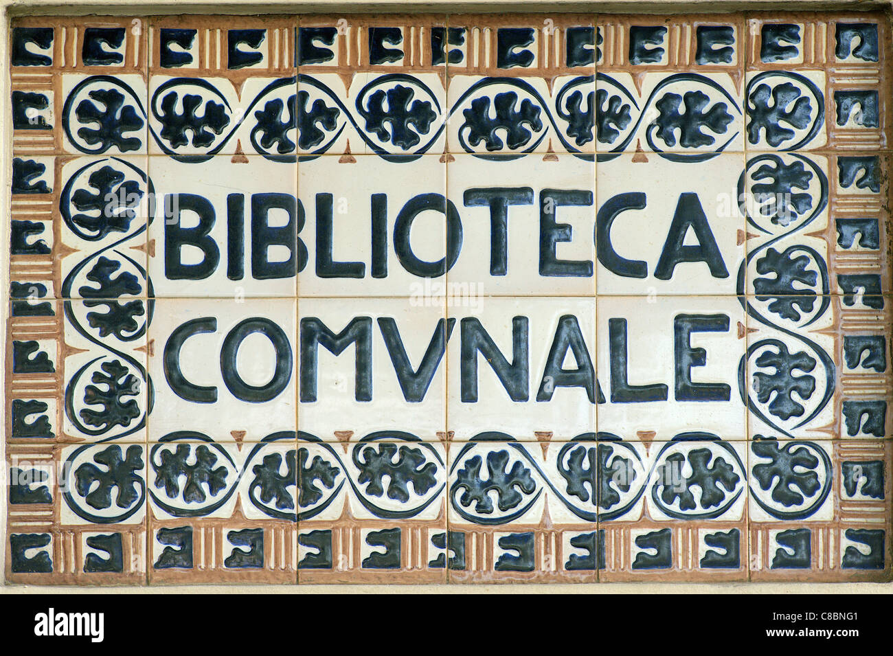 Biblioteca Comunale Faenza Italy communal library name made of tiles - Stock Image