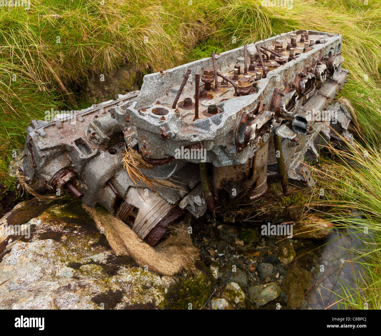 Wrecked Rolls Royce V12 Merlin engine from a Halifax bomber air crash site. - Stock Image