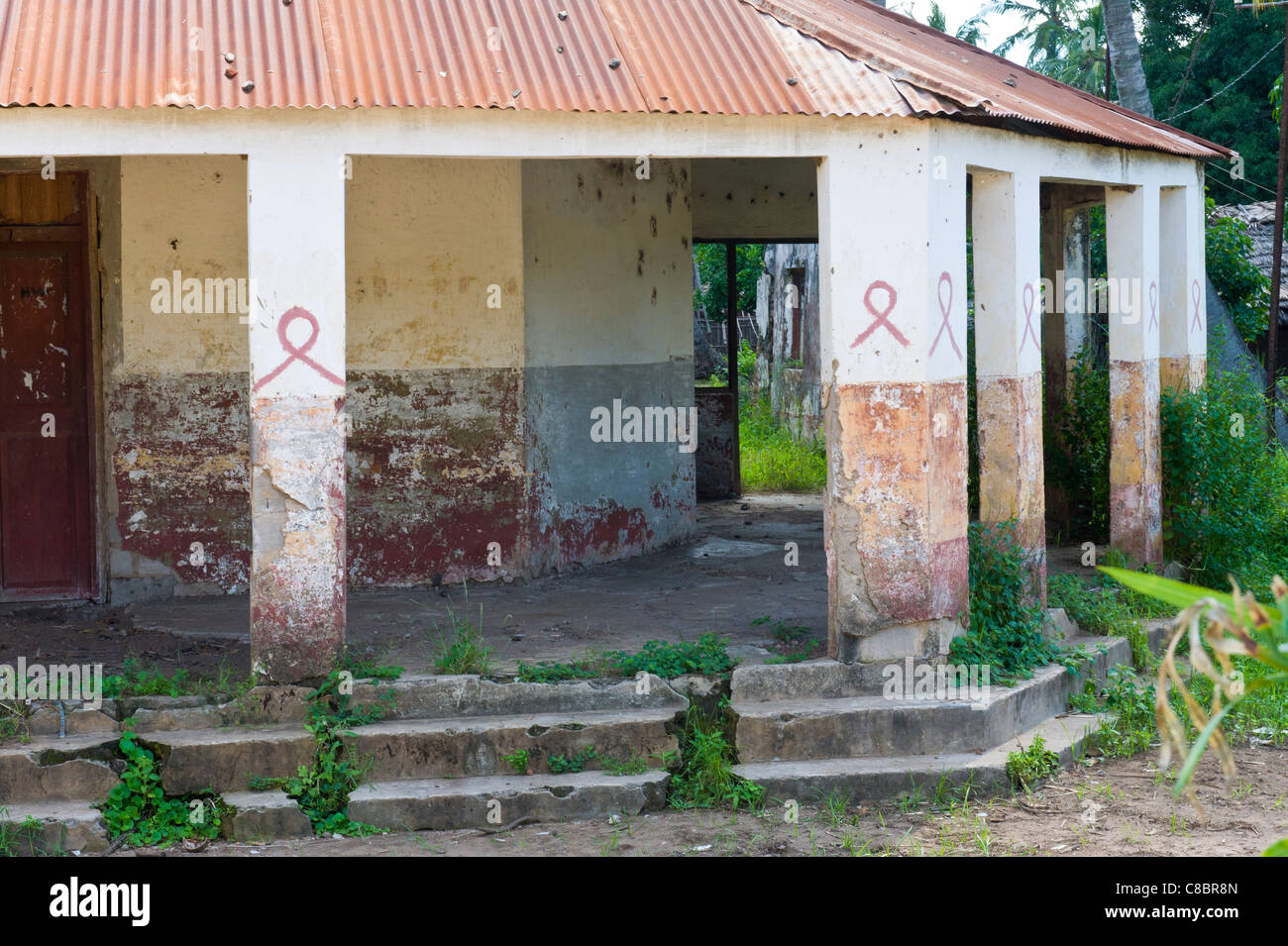 The red ribbon is an international symbol of AIDS awareness in Quelimane Mozambique - Stock Image