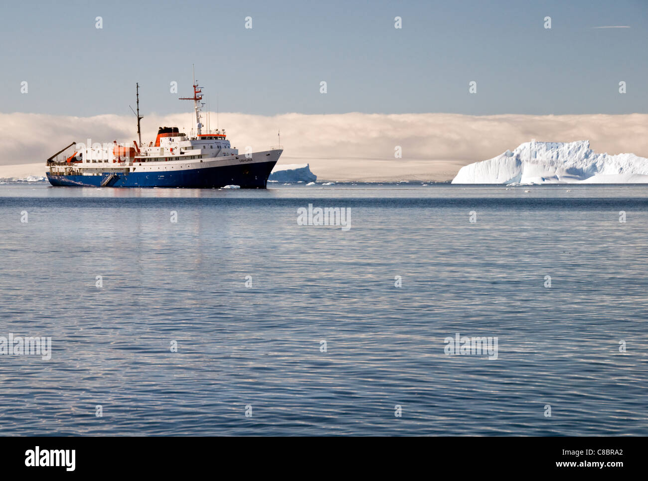 Antarctic expedition vessel the MV Ushuaia anchored in Antarctica - Stock Image