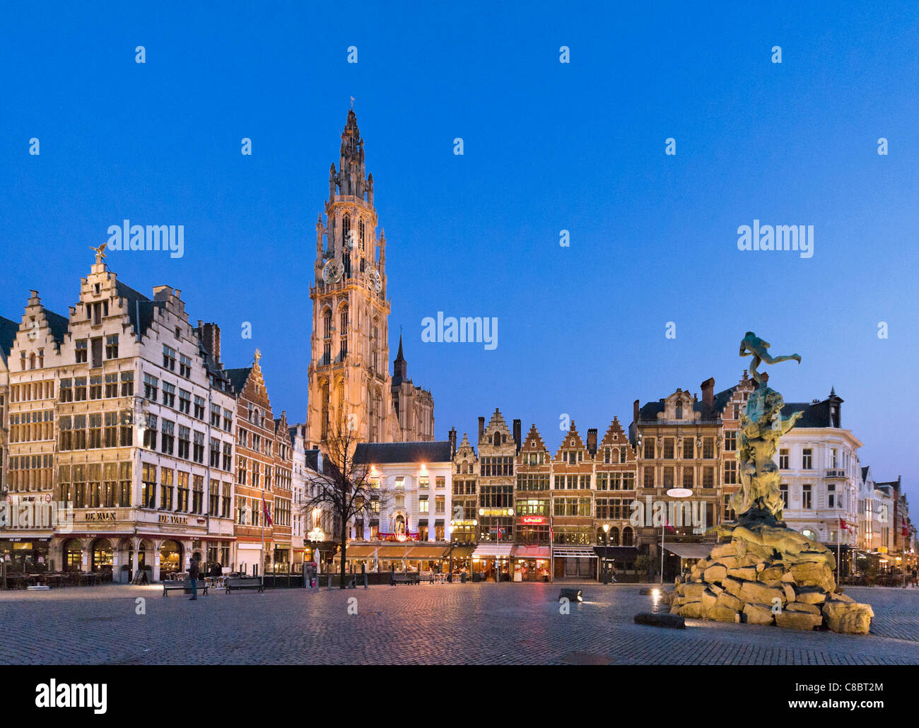 The Grote Mark (Main Square)and Brabo Fountain at night with Onze Lieve Vrouwekathedraal (Cathedral) behind, Antwerp, Stock Photo