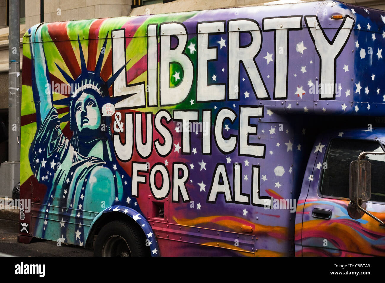The Statue of Liberty painted on the side of a truck with the words, 'Liberty & Justice for All' at - Stock Image