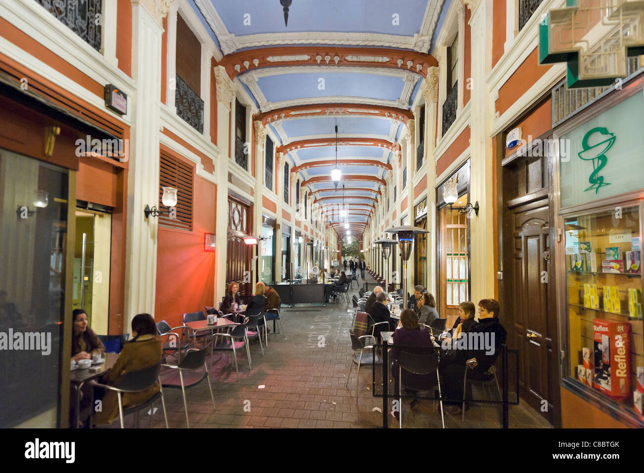 Cafe at night in an arcade just off the Plaza del Pilar, Zaragoza, Aragon, Spain - Stock Image