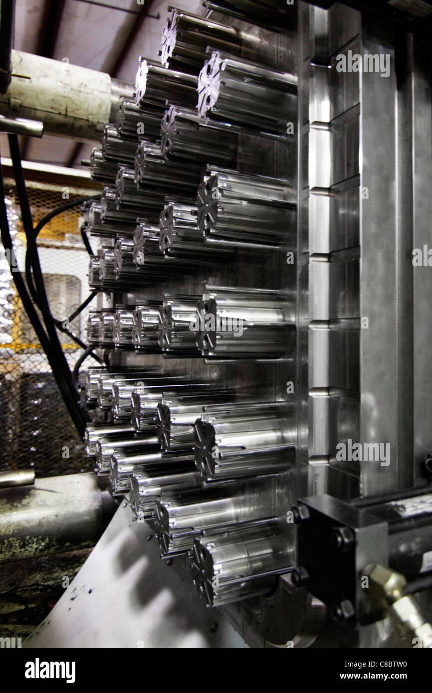 A plastics molding injection machine in Hudson, Colorado, USA. - Stock Image