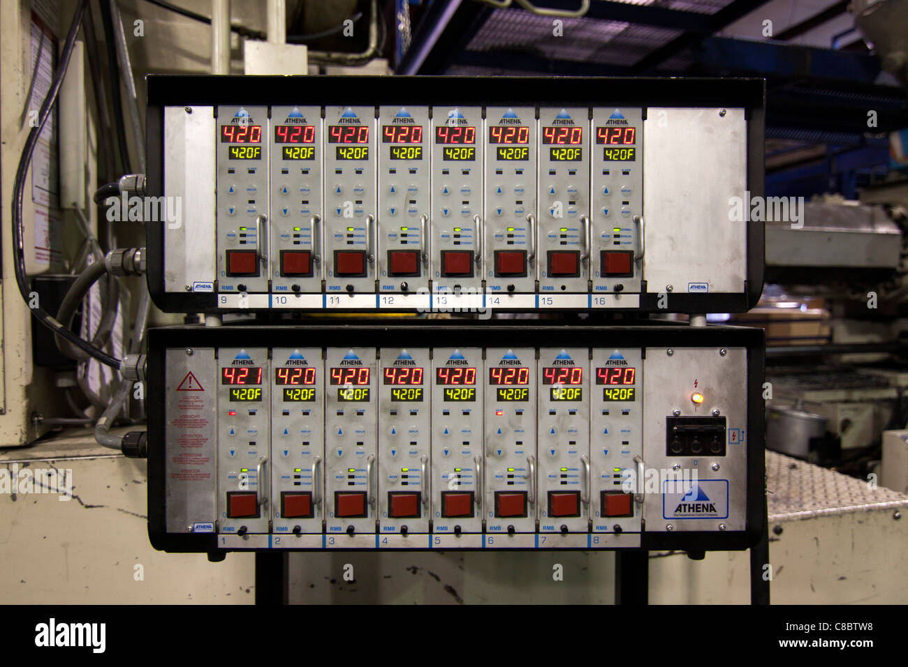 An athena temperature control panel at a plastics molding injection plant in Hudson, Colorado, USA. - Stock Image