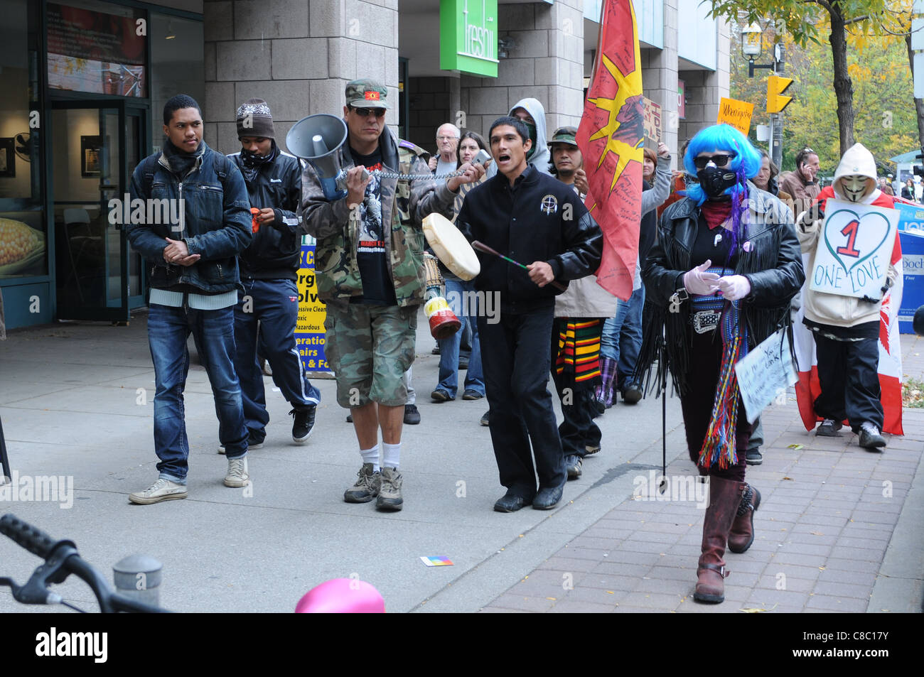 The Occupy Toronto protest movement, unidentified First Nations marchers in downtown Toronto, October 18, 2011. - Stock Image